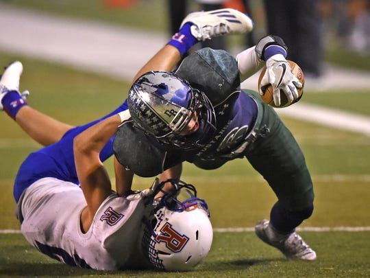 Damonte Ranch's Ryon Hurley is tackled near the end zone by Reno's Will Hart in the second half of Thursday's 4A semifinal game.