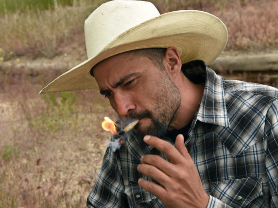 Rancher Josh White, who has a medical marijuana card, rolls and lights up a joint on in Elko, Nevada on May 19, 2017.   White is co-owner of Cannabis Consulting Group INC, a professional consulting services on all aspects of the marijuana industry.