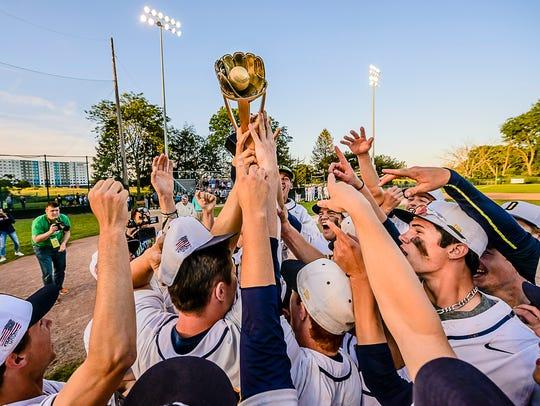The DeWitt baseball team hoists the Diamond Classic