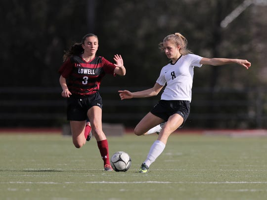 U-Prep's Madison Kremer, right, gets ready to kick the ball while being defended by Lowell's Audrey Fuchs during the NorCal regional playoffs Thursday in Redding. The Panthers lost the match 2-1.