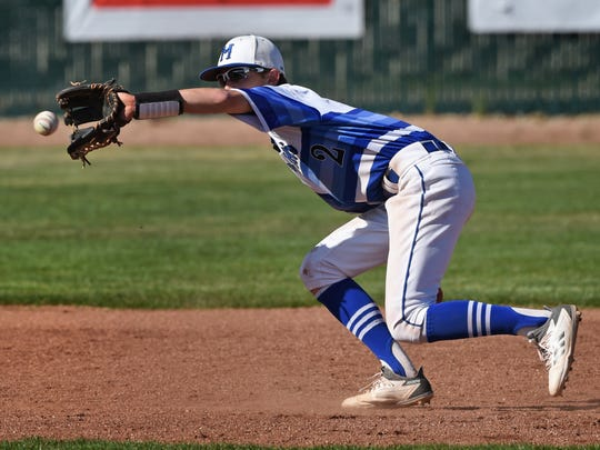 McQueen's Logan Anderson makes catch for the Lancers during Tuesday's game against Reed. Reed won, 9-5.