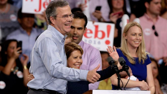 Jeb Bush with his wife,  Columba, center, and other family members on June 15, 2015, in Miami.