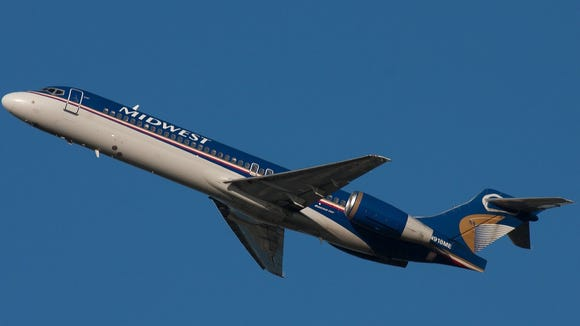 A Midwest Boeing 717 is seen flying on Sept. 10, 2008.