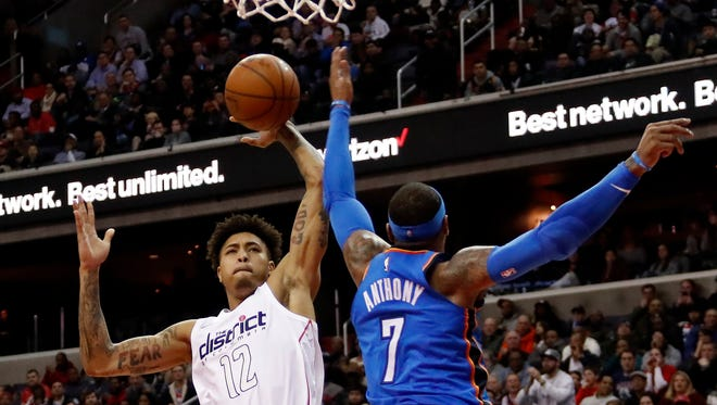Washington Wizards forward Kelly Oubre Jr. (12) attempts to dunk the ball as Oklahoma City Thunder forward Carmelo Anthony (7) defends.