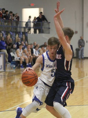 White House's Jared Ward drives into White House Heritage's Tyler Weber during Tuesday's game.