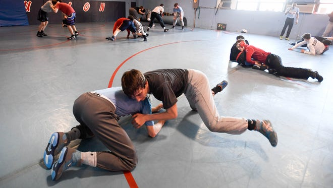 Sam Bacon (left) and Trevor Pogue practice wrestling moves as the Union County High School Wrestling Team prepares for the Kentucky State Wrestling Final in Lexington Tuesday, February 13, 2018.