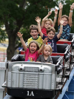 Kids ride the kiddie roller coaster during Playland's final day of the 2013 season, Sept. 2.