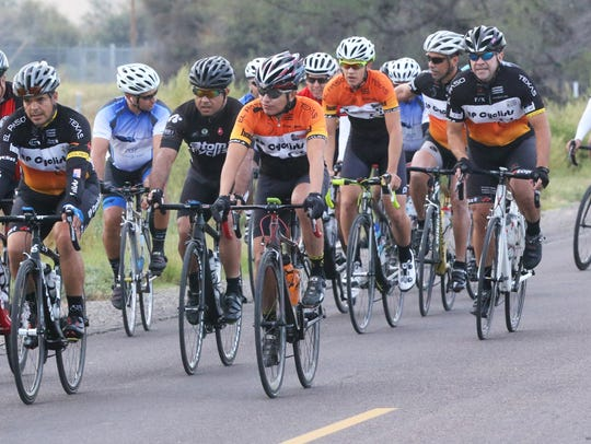 Cyclists start off on the 50-mile race during the third