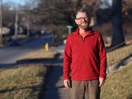 Todd McBride, a Capitol Park neighborhood homeowner stands outside his house along Pennsylvania Avenue on Thursday, Dec. 29, 2016, in Des Moines.