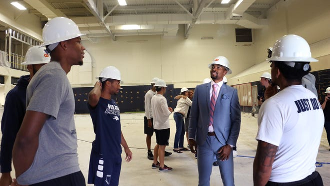 Ex-Wolf Pack basketball player Ramon Sessions, middle right, hangs with current players while checking out the new Ramon Sessions Basketball Performance Center on the campus of the University of Nevada, Reno on Sept. 15, 2017. Jason Bean/Reno Gazette-Journal- USA TODAY NETWORK