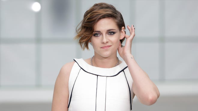 Kristen Stewart poses for photographers  as she arrives for Chanel 's Spring-Summer 2015 Haute Couture fashion collection, presented in Paris, France, Tuesday, Jan. 27, 2015.