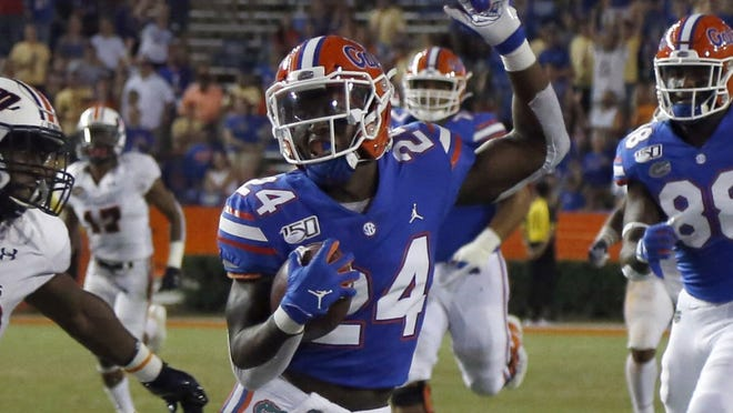 Florida running back Iverson Clement picks up yardage last year against Tennessee Martin at Ben Hill Griffin Stadium.