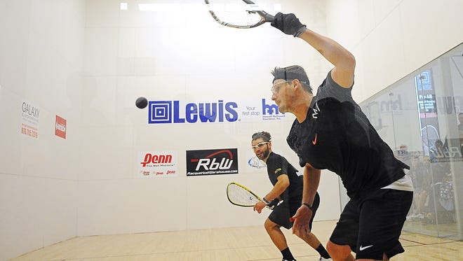 Kane Waselenchuk, right, takes on Jose Rojas in the men's singles pro final during the Lewis Drug Pro-Am racquetball tournament Sunday, Jan. 24, 2016, at the Sioux Falls Family YMCA in downtown Sioux Falls.