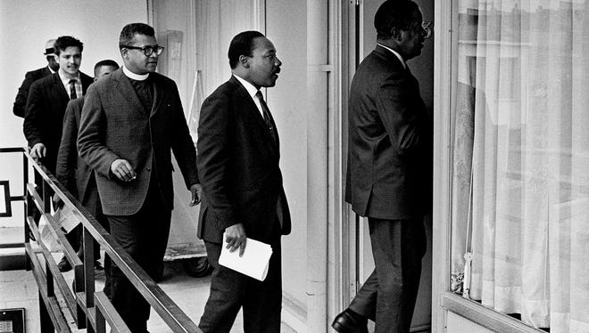 "On April 3, 1968, the Rev. Ralph Abernathy led Dr. Martin Luther King Jr., the Rev. James M. Lawson Jr. and others into Room 307 at the Lorraine Motel to discuss a restraining order King had just received barring he and his aides from leading another march in Memphis without court approval. On March 28, a march led by King on behalf of striking sanitation workers erupted into violence along Main and Beale streets. King, who was staying in Room 306, also met with young people and other groups of strike supporters who wished to be part of future protests. ""Dr. King made it very clear to me that day that his whole future depended on having a nonviolent march in Memphis. He represented the riot as a complete fiasco ...,"" said attorney Lucius Burch. The march, tentatively planned for Friday, April 5, was rescheduled for the following Monday to allow time for marchers from around the country to participate. On April 4, at 6:01 p.m., an assassin's bullet found King on the balcony of the Lorraine just outside his second-floor room. Behind Lawson is Jesse Epps (hidden), AFSCME field representative; Bill Mahoney, SCLC staff; and Solomon Jones (hidden behind Mahoney), King's chauffeur while in Memphis."