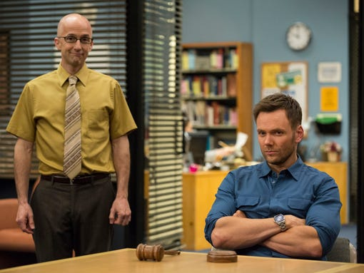 "This photo released by NBC shows, Jim Rash, left, as Dean Pelton, and Joel McHale as Jeff Winger, in a scene from season 5 of ""Community."" Yahoo says that it's giving the sitcom ""Community"" a sixth season online. Yahoo and Sony Picture Television announced Monday, June 30, 2014, that the show's creator, Dan Harmon, will serve as an executive producer for 13 new episodes.(AP Photo/NBC, Justin Lubin)"