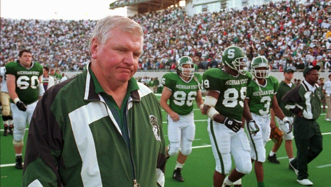 Michigan State head football coach George Perles walks off the field at Spartan Stadium after a loss to Notre Dame on Sept. 17, 1994. Perles, now an MSU Board of Trustees member, was fired later that season amid an NCAA investigation.