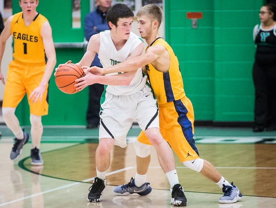 Yorktown's Bobby Smith fights for possession against