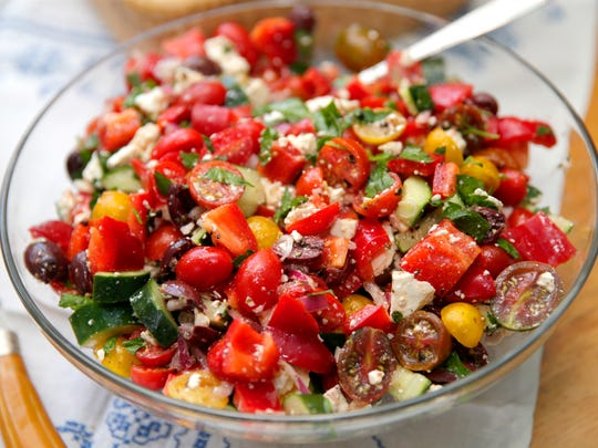 A colorful Greek salad brings the sunny Mediterranean to the table.