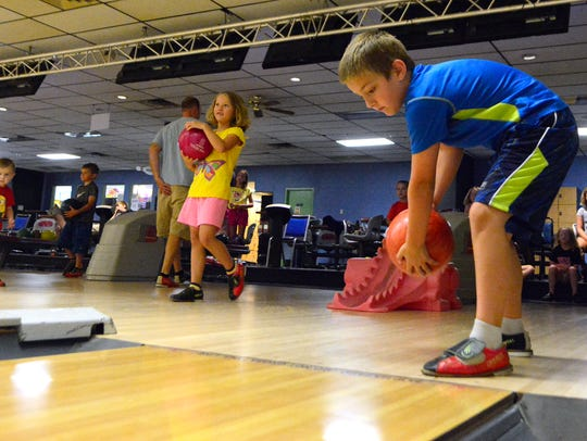 Bryton Peterson, 9, of Dover, rolls the ball while