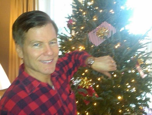 Bob McDonnell wearing his Rolex in front of a Christmas tree
