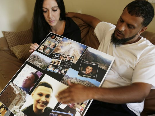 Amanda Mosed, of Dearborn Heights and her ex-husband Fadhl Mosed, of Detroit, look at photos of their 13-year-old son Jayzon who was shot to death during a visit with family to Yemen in October 2014.