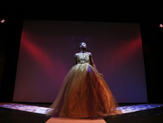 Model Rosine Diwutu Yanyi wears a Ann DeEvelyn Clothing Co. dress designed by Frances Lewis at the Revelations fashion show.