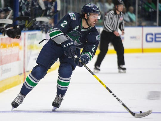 Everblades defender Gus Young maneuvers the puck down