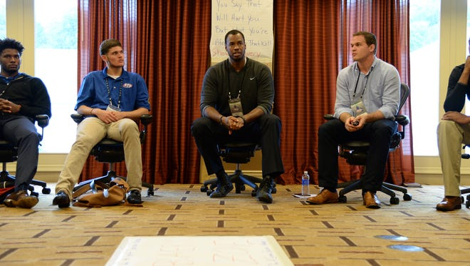 Jason Collins, middle, and Hudson Taylor, right, speak at the NBA Rookie Transition program in Florham Park, N.J. on Aug. 11.
