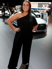 Zoe Loridas, 22 of South Lyon shows off her pants suit during the 2018 North American International Auto Show Charity Preview at Cobo Center in Detroit on Friday, January 19, 2018.