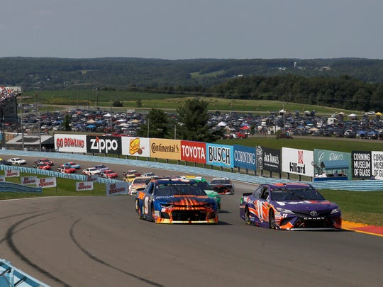 Monster Energy NASCAR Cup Series drivers Chase Elliott (9) and Denny Hamlin (11) at the start of the Go Bowling at The Glen at Watkins Glen International in 2018.