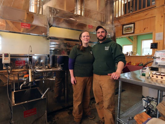 Jennifer and Mark Soukup, of Soukup Farms in Dover Plains, are pictured with the evaporator in the sugar house on the property, March 25, 2017.