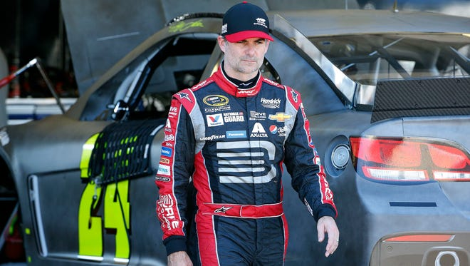Jeff Gordon walks back to his trailer during NASCAR Sprint Cup race testing at Phoenix International Raceway on Wednesday, Oct. 14, 2015, in Avondale.