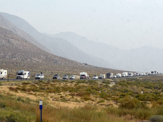 A long line of cars, trucks and RVs snakes around a while leaving the Burning Man encampment area on Sept. 4, 2017 during the departure event known as Exodus.