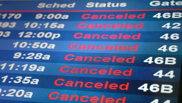Screens display cancelled flights at Newark Liberty