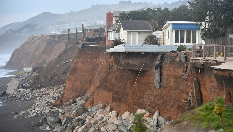 Sections of land are seen missing from coastal properties in Pacifica, Calif., on Jan. 26, 2016. Storms and powerful waves caused by El Niño have been intensifying erosion along nearby coastal bluffs and beaches in the area.