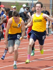 Salesianum's Jeremy Ryan receives the baton from James Haffey in the 4x100 meter relay at the state track meet at Dover High School.