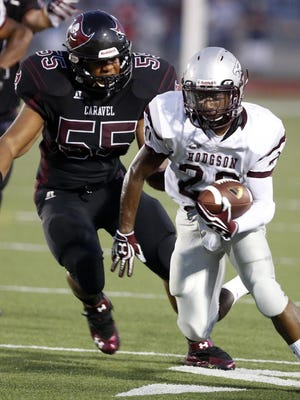 Hodgson football's Dejuan Outlaw (right) rushed for 221 yards and four touchdowns against Lake last Friday.