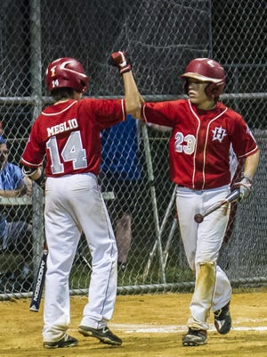 (L-R) Holbrook's Charlie Meglio (14) congratulates teammate Christopher Cartnick (23) after Cartnick scores in the 5th inning at the game 2 of the NJ State Little League Tournament at Kittatinny Little League 1 in Newton, July 27, 2017. (Photo by Warren Westura for the Asbury Park Press)