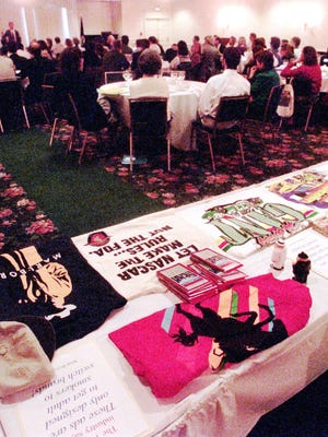 A table of cigarette company promotional materials sits at the rear of a conference on smoking prevention in Montpelier on April 9, 1996. Officials at the conference said Vermont can fight the powerful cigarette companies with education, taxation and common sense.