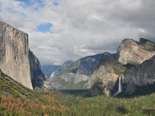This is the classic Tunnel View of Yosemite National Park, with El Capitan, Half Dome and Bridalveil Falls visible.
