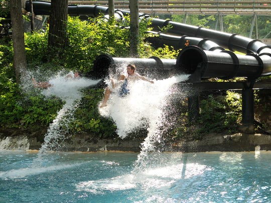 Patrons at Action Park fly out of a waterslide in this 2014 photo