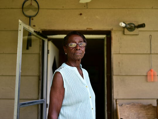 Bobbie Smith, grandmother of Olympic athlete Tori Bowie, stands on the front porch of her home in Pisgah Tuesday afternoon.