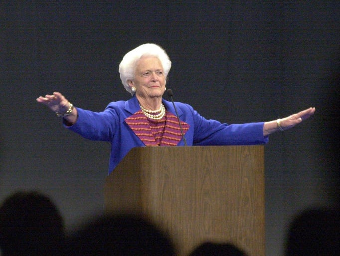 Former first lady Barbara Bush quiets the crowd after
