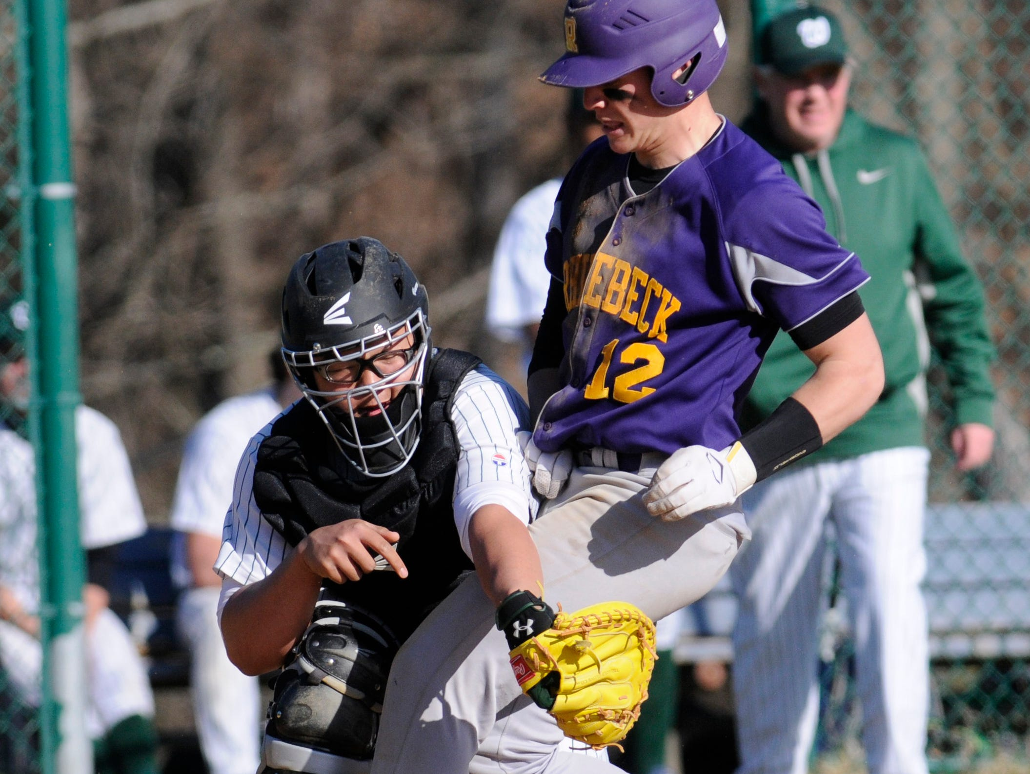 Rhinebeck's Spencer Hutchins collides with Webutuck's catcher, Ethan Lounsbury during Wednesday's game at Rhinebeck.