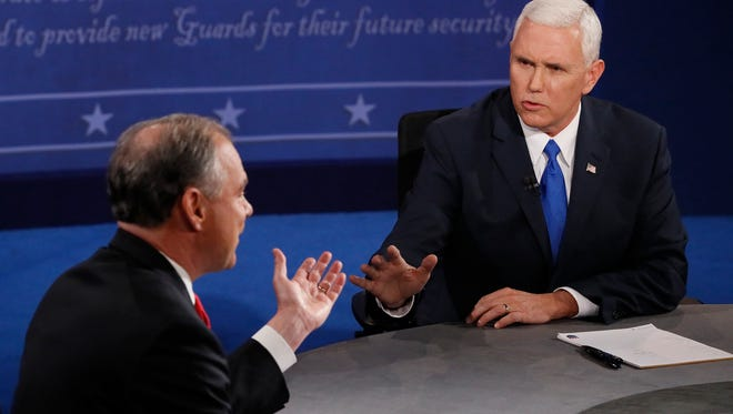 Republican nominee Gov. Mike Pence (right) and Democratic nominee Sen. Tim Kaine sparred during the vice presidential debate Tuesday, Oct. 4, 2016, at Longwood University in Farmville, Va.