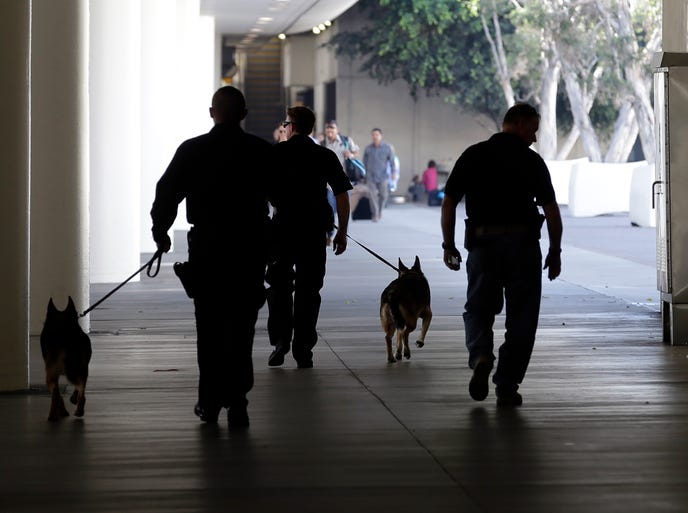Police check the area around Terminal 1 at Los Angeles International Airport on Nov. 1, 2013. A gunman armed with a semiautomatic rifle opened fire at the airport killing a Transportation Security Administration employee and wounding other people.