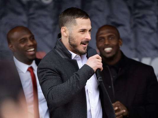 New England Patriots wide receiver Danny Amendola, center, addresses the crowd as strong safety Duron Harmon, left, and free safety Devin McCourty, right, smile during an NFL football Super Bowl send-off rally, Monday, Jan. 29, 2018, in Foxborough, Mass. The Patriots are to play the Philadelphia Eagles in Super Bowl 52, Sunday, Feb. 4, in Minneapolis. (AP Photo/Steven Senne)