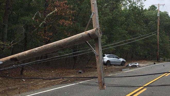 Police said a car struck a pole in Howell on Sunday, triggering a road closure and arrest of the driver.