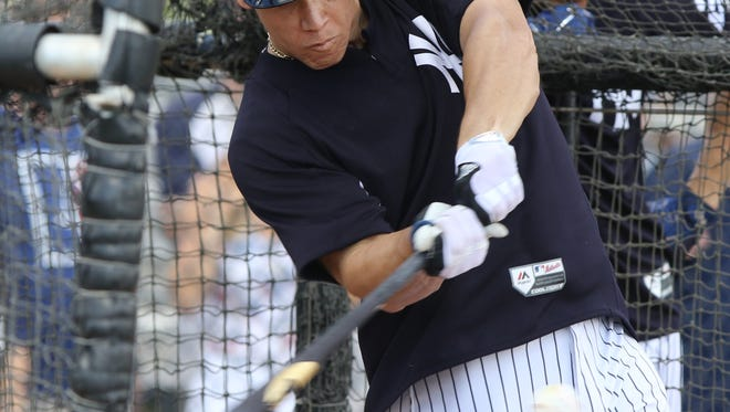 Aaron Judge connects with the ball during batting practice.