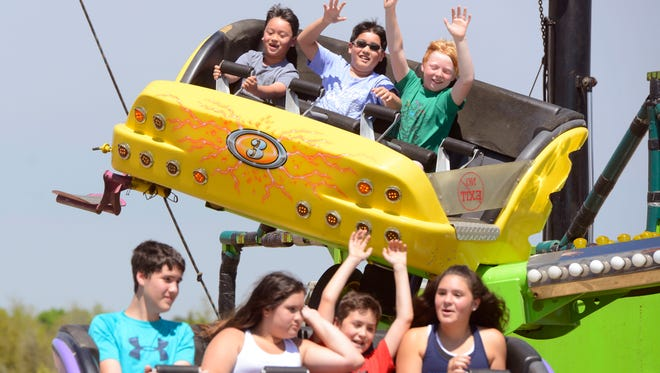 Kids ride the Catch 'N Air at a previous Santa Rosa County Fair in Milton. This year's fair gets underway on Thursday.